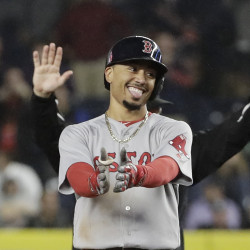 Boston's Mookie Betts is all smiles after hitting a two-run double in the eighth inning  Associated Press/Frank Franklin II