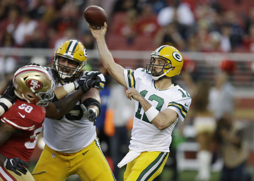 Green Bay quarterback Aaron Rodgers could have a rebound year as his offensive teammates figure to be healthier than last season.    Associated Press/Ben Margot