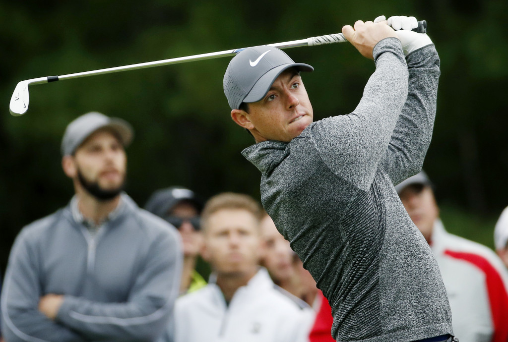 Rory McIlroy of Northern Ireland tees off on the third hole during the final round of the Deutsche Bank Championship golf tournament in Norton, Mass., on Monday. (AP Photo/Michael Dwyer)