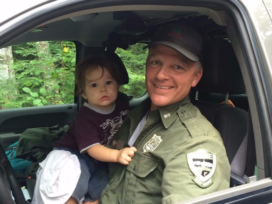 Maine Game Warden Jim Fahey found a missing 18-month-old boy about half a mile from his home in Bradford after the boy wandered away.
