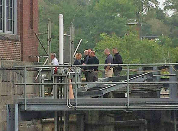 Authorities are on the scene near the Lockwood Dam Tuesday morning as a body is recovered from the water. <em>Photo by Madeline St. Amour/Central Maine</em>
