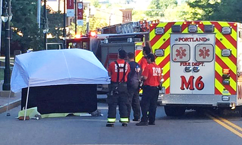 Portland police and fire on Congress Street Thursday morning where a man apparently jumped to his death.