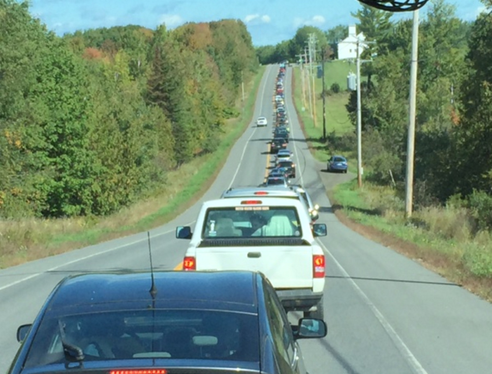 Traffic headed to the Common Ground Fair stretches ahead of the bus from which the author took this picture.