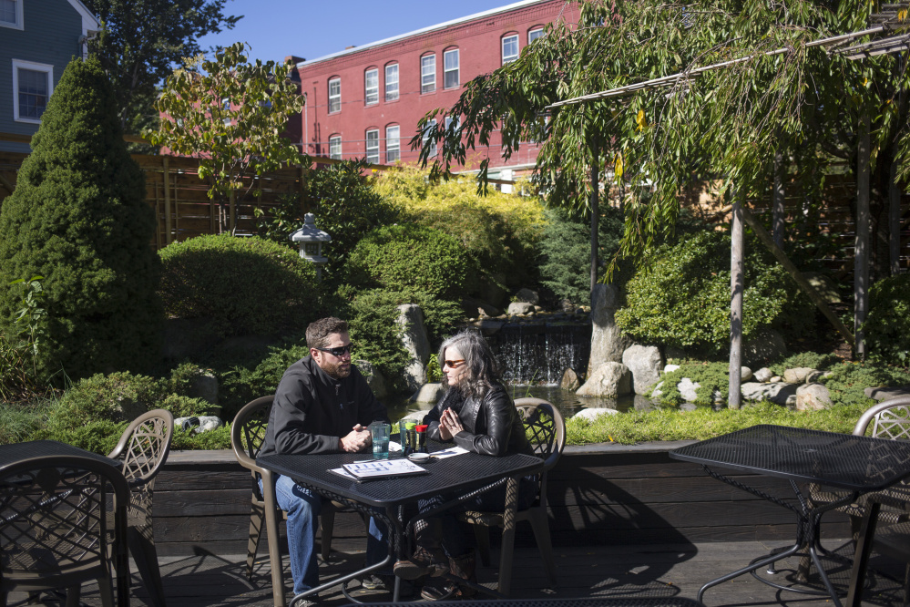 Brian and Amy Chamberlain of Gorham, New Hampshire, enjoy the Japanese-style pond and greenery on the patio. The couple used to frequent Yosaku when they lived in Portland.