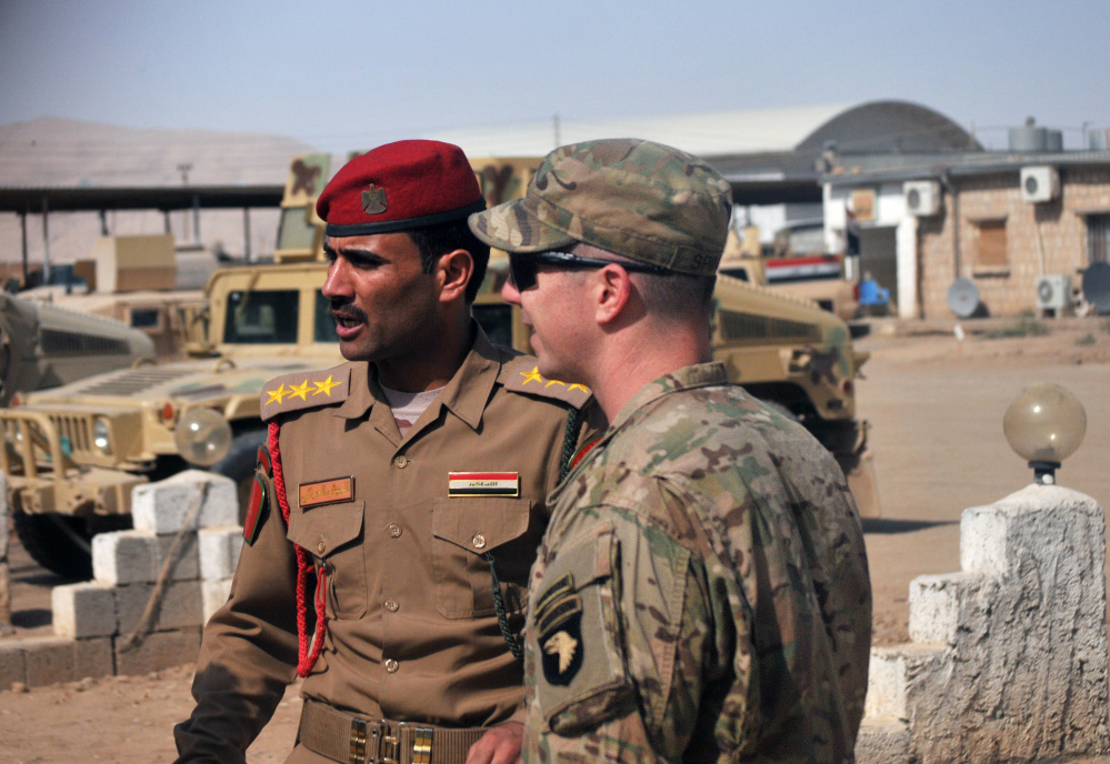 U.S. Army Capt. Gerrard Spinney, right, speaks to his counterpart in the Iraqi army before a Sept. 6 security meeting at Camp Swift, Iraq. Speeding up the Mosul offensive could set the stage for catastrophe.