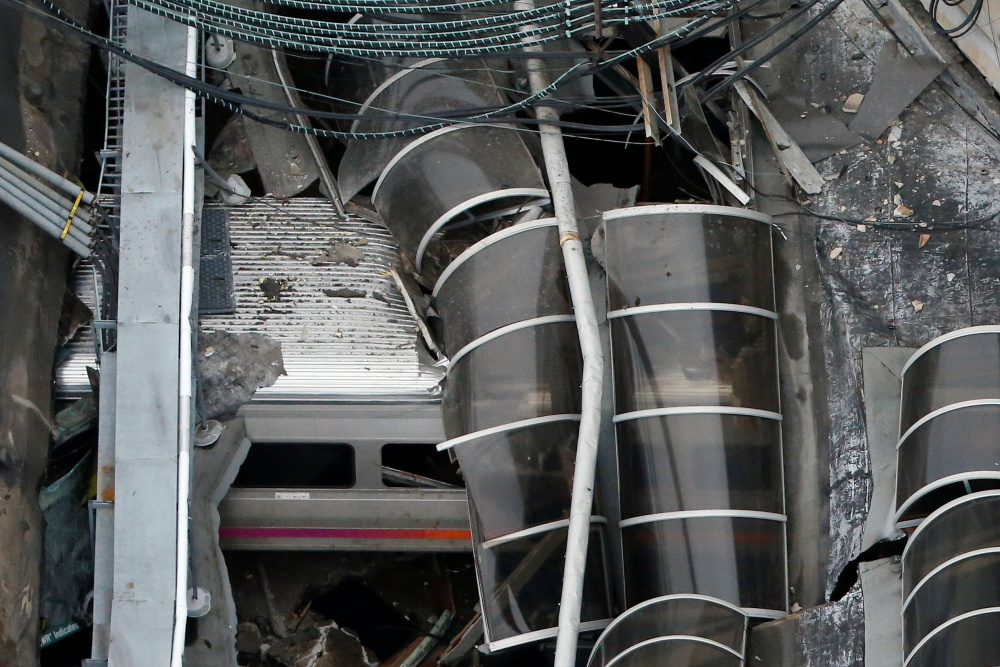 A train car appears in an aerial photo inside the New Jersey Transit Hoboken Terminal after a train crash Thursday that killed one person and injured more than 100 others.