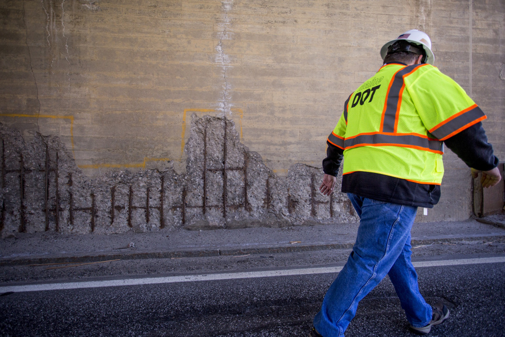 Maine DOT press secretary Ted Talbot walks off the Route 1 Viaduct in Bath past some corrosion on the bridge supporting High Street last April.  Gabe Souza/Staff Photographer