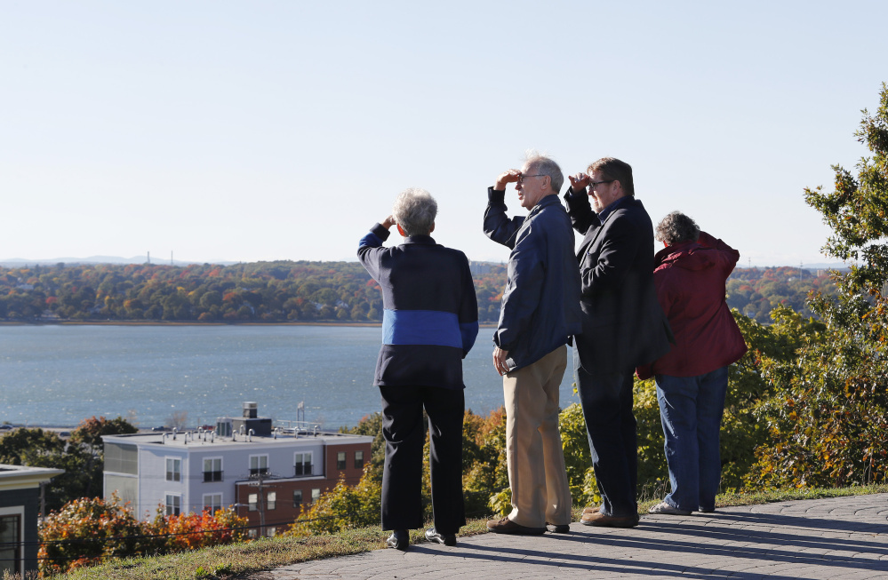 Jane Ives, Cliff Ives, Jeff Taylor and Mary Taylor take in the view from Munjoy Hill's Fort Sumner Park on Monday. Portland City Councilor Belinda Ray wants to enact a two-month moratorium on development projects abutting public open space in the East End.