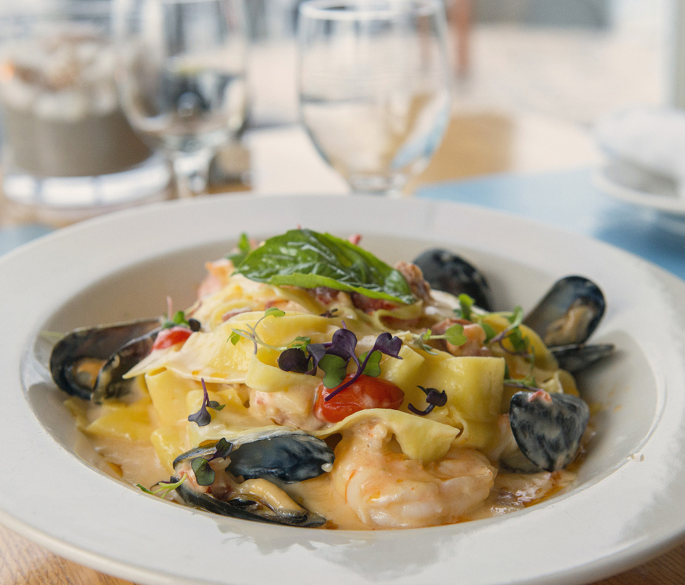 Everything comes together in the seafood pappardelle. John Ewing/Staff Photographer