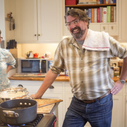 Cathy Silva of Port Charlotte, Fla., and her brother Brett Johnson, in the kitchen of their family home on Bailey Island while making their Nana, Eileen Johnson's, fried lobster.