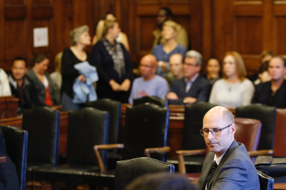 Landlord Gregory Nisbet sits in the courtroom Friday as family members of the victims of the Noyes Street fire react to the not guilty verdicts from Justice Thomas Warren.