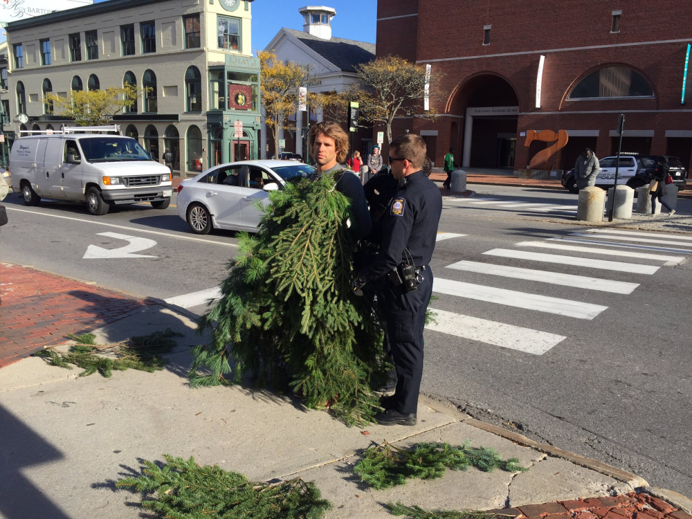 Asher Woodworth says dressing as a tree and slowly crossing a busy intersection on Monday in Portland, for which he was arrested, was conceived as a piece of performance art.