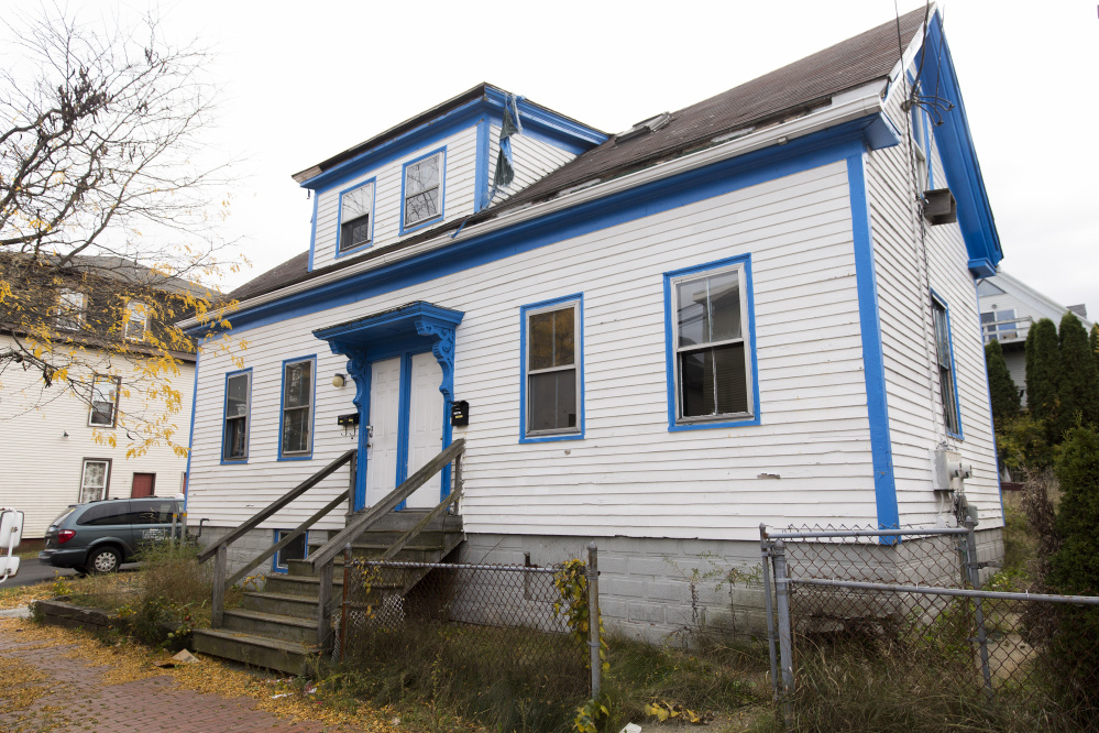 The two-family home at 30 Merrill St. is going to be knocked down and replaced with hyper efficient 7 unit condos. Brianna Soukup/Staff Photographer