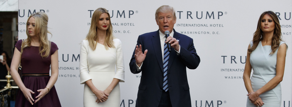 Republican presidential candidate Donald Trump, accompanied by, from left, Tiffany Trump, Ivanka Trump and Melania Trump, speaks during the grand opening of the Trump International Hotel in Washington on Wednesday.