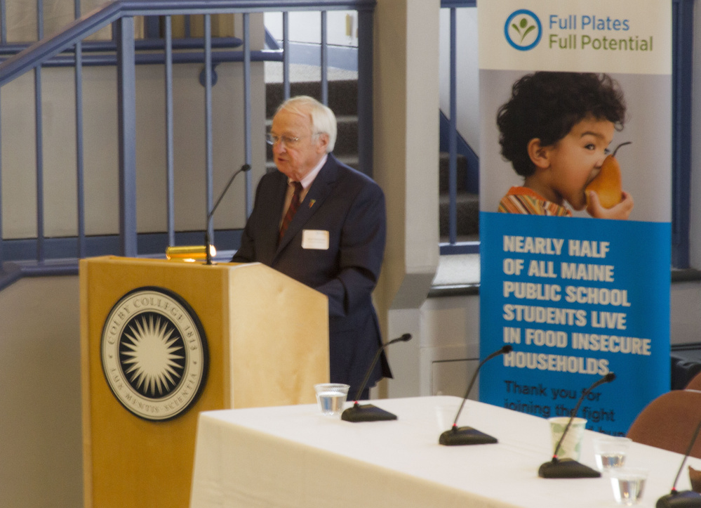 Kevin Concannon gives the keynote speech at a summit on childhood hunger at Colby College.
