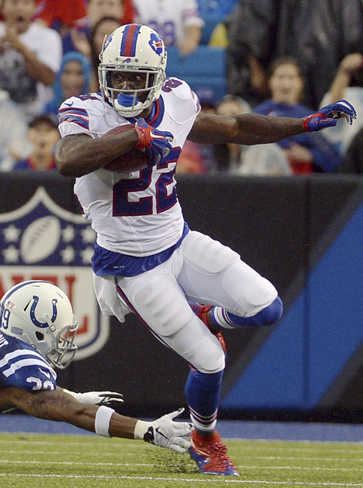Buffalo Bills running back Reggie Bush (22) eludes Indianapolis Colts defensive back Tay Glover-Wright (39) during the first half of a preseason NFL football game Saturday, Aug. 13, 2016, in Orchard Park, N.Y. (AP Photo/Adrian Kraus)