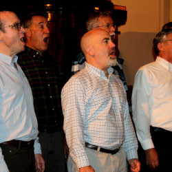 """Members of the Maine Gay Men's Chorus sing """"Let There Be Peace on Earth"""" as part of the evening honoring lawyer Mary Bonauto's work in protecting civil rights related to gender and sexual preference."""