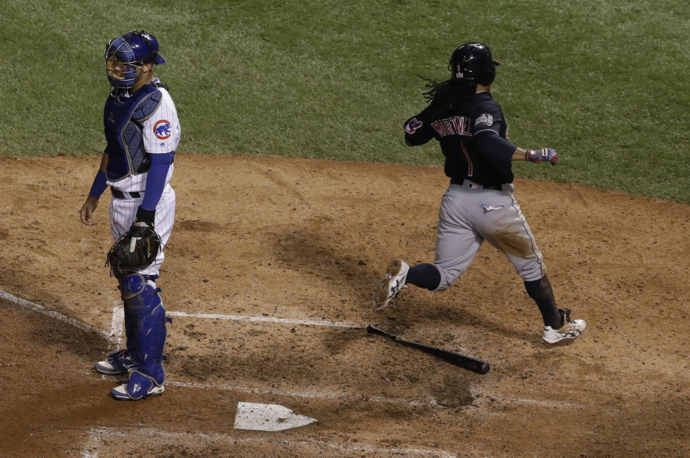 Michael Martinez of the Indians scores past Cubs catcher Willson Contreras in the seventh inning for the only run of Game 3 of the World Series Friday night in Chicago.