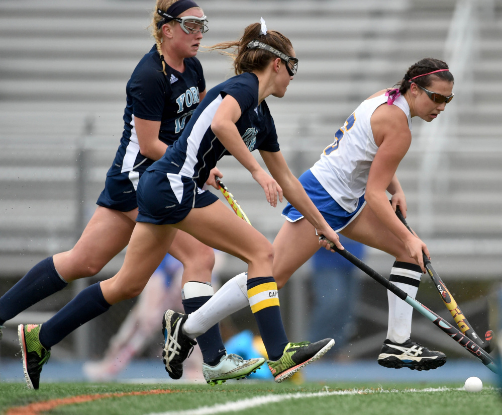 Belfast's Kylie Nelson, right, drives the ball down the field as York's Alexandra Lawlor defends in the Class B state championship game in Bath on Saturday. York defeated Belfast 2-1.