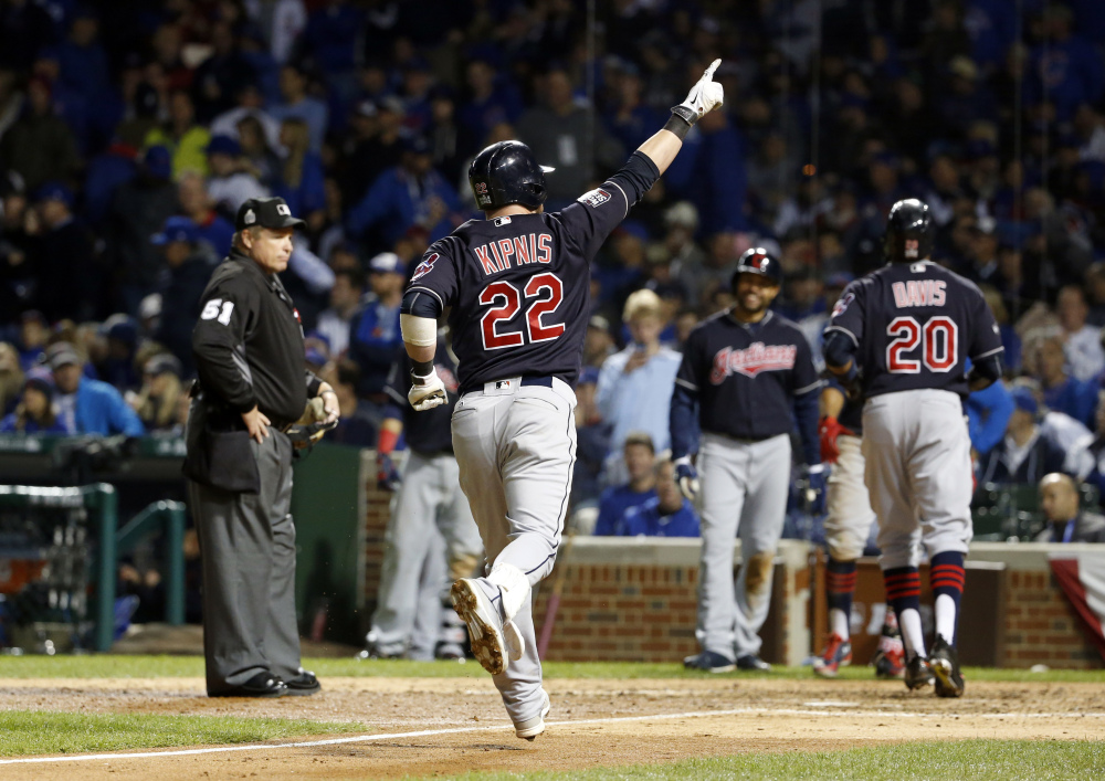Cleveland Indians' Jason Kipnis celebrates after hitting a three-run home run during the seventh inning of Game 4 of the World Series against the Cubs on Saturday in Chicago.