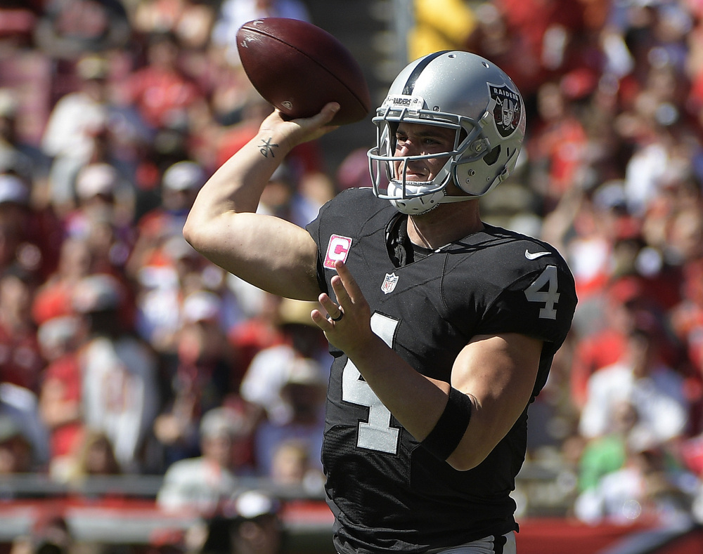 Raiders quarterback Derek Carr capped a 513-yard four touchdown performance Sunday with a 41-yard touchdown pass to Seth Roberts in overtime.