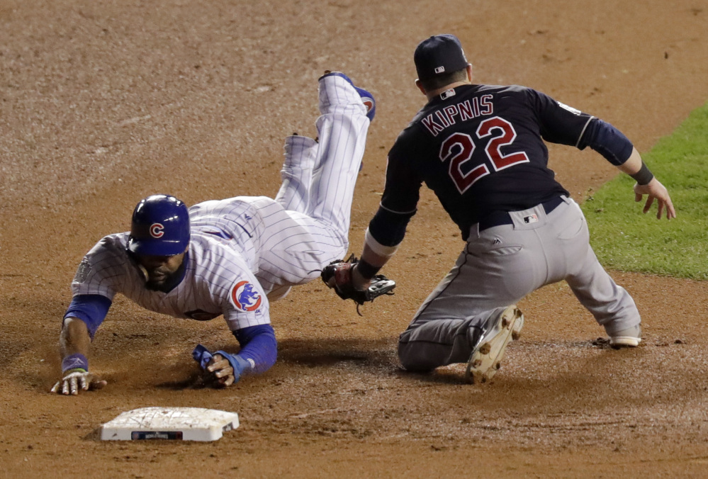 Chicago Cubs' Jason Heyward steals second past Cleveland Indians second baseman Jason Kipnis during the eighth inning of Game 5 of the World Series on Sunday in Chicago.