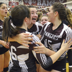 Greely's Claire Davis, 6, Molly Chapin, center, and Jane Grandchamp  celebrate the Rangers' volleyball championship.
