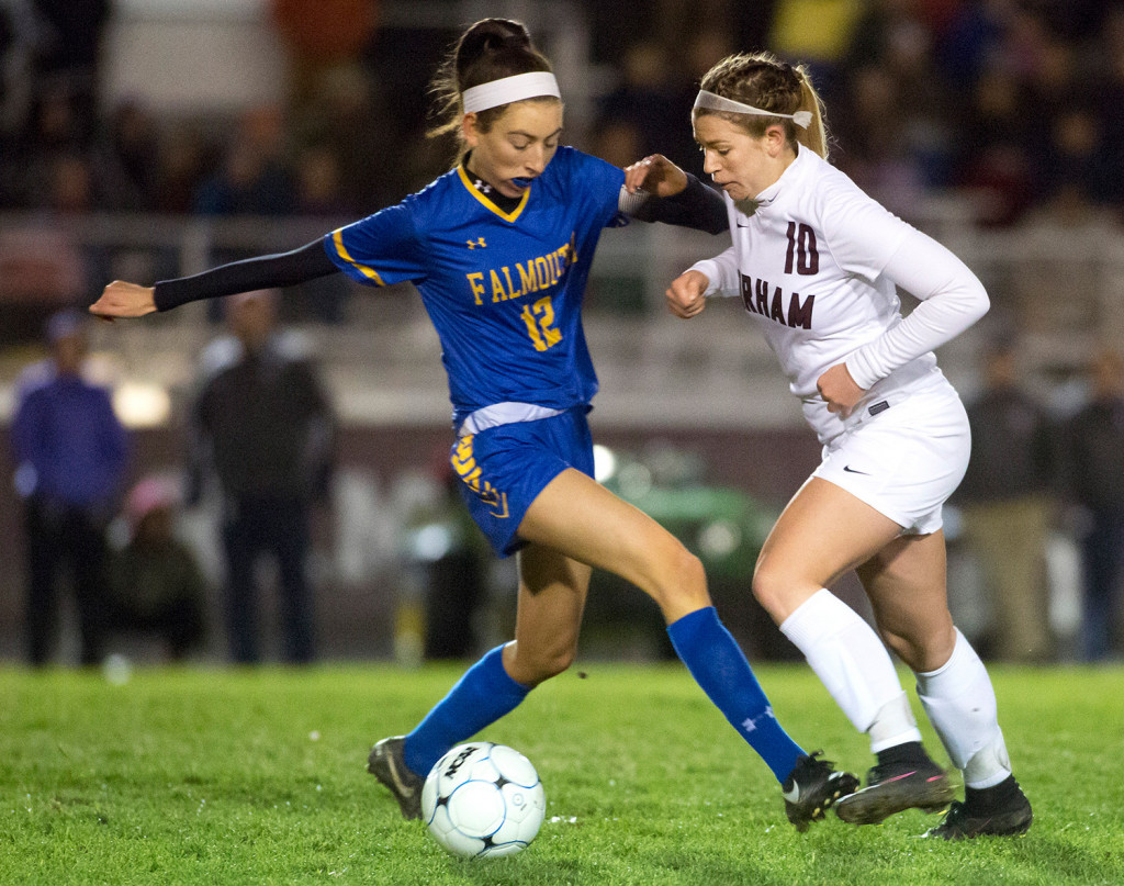 Gorham senior and team captain Meghan Perrin defends against Falmouth senior and team captain Mia Cooney during Monday's Class A South semifinal at Gorham. Gorham won, 2-0, to reach the final.