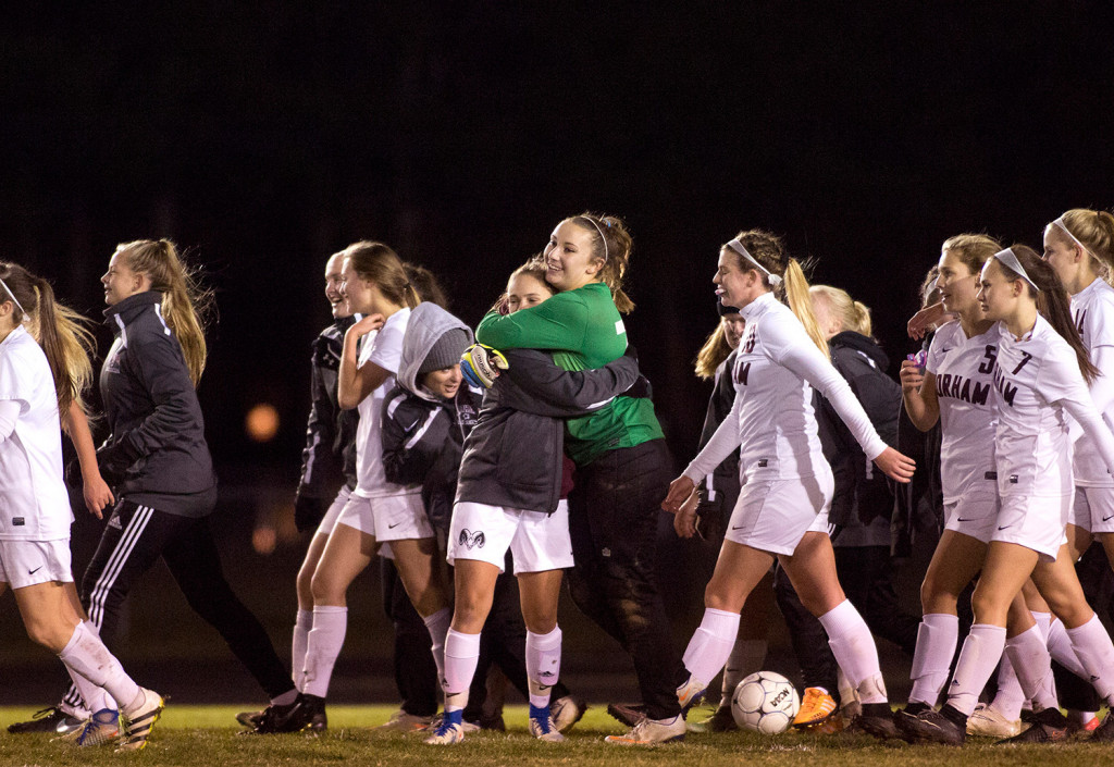 Gorham players celebrate after winning a berth in the Class A South final with a 2-0 win over Falmouth on Monday.