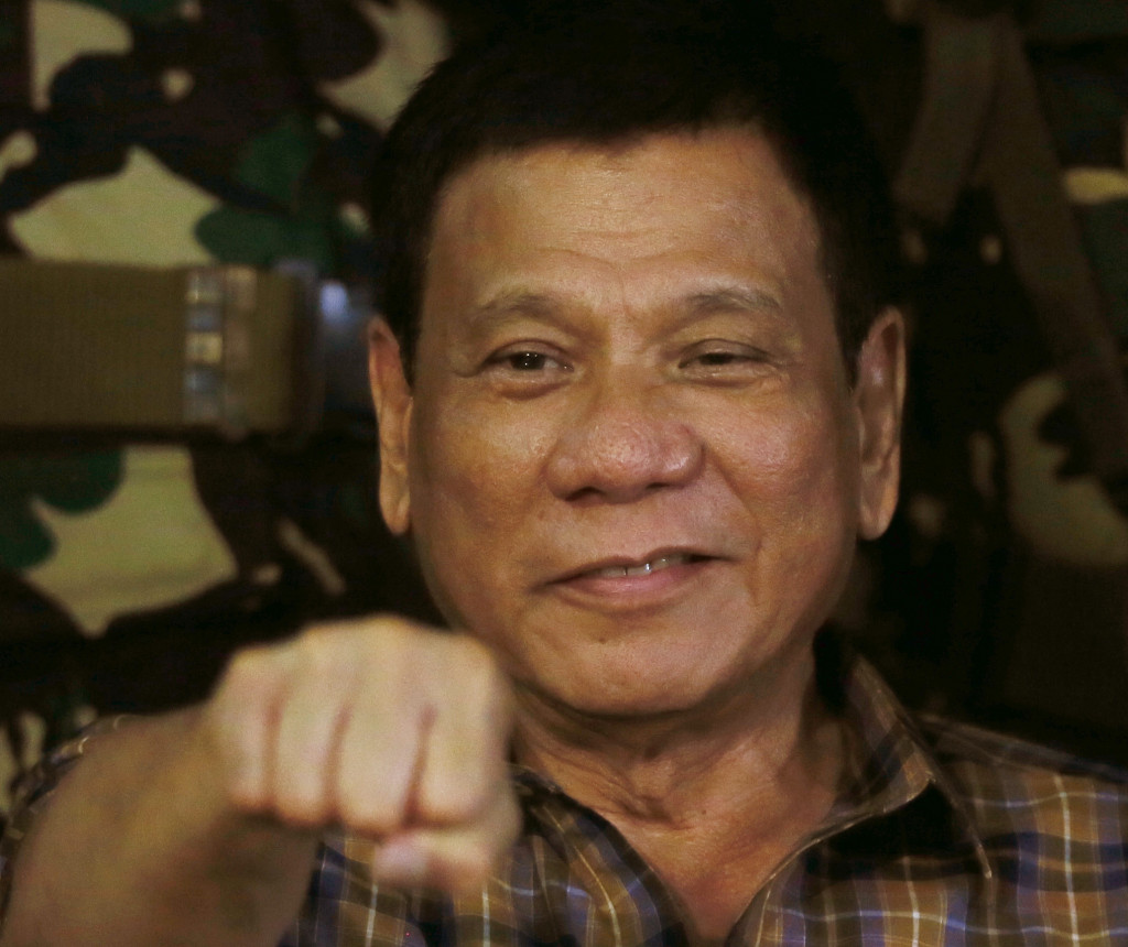 Philippine President Rodrigo Duterte gestures with a fist bump during a visit to an army camp on Aug. 25. Associated Press/Bullit Marquez