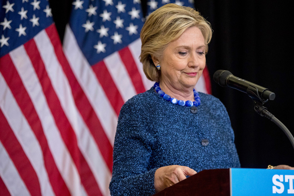 Hillary Clinton pauses while speaking at a news conference in Des Moines, Iowa, on Friday after the FBI announced that it is investigating whether new emails involving the Democratic presidential nominee contain classified information.