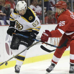 Detroit Red Wings defenseman Danny DeKeyser tries to steal the puck from Boston Bruins left wing Brad Marchand during the first period Saturday in Detroit.  Associated Press/Duane Burleson