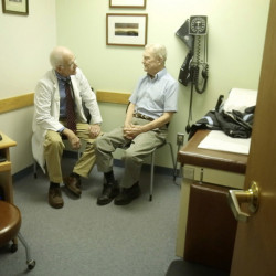 Dr. William Medd talks with patient Frank Floster at Medd's primary care practice in Norway in 2014. Now 73, Medd is still practicing medicine, but he worries about who will take his place when he retires, he has told the Press Herald – and the approval of Question 2 would make it even harder to encourage young doctors to come to Maine.