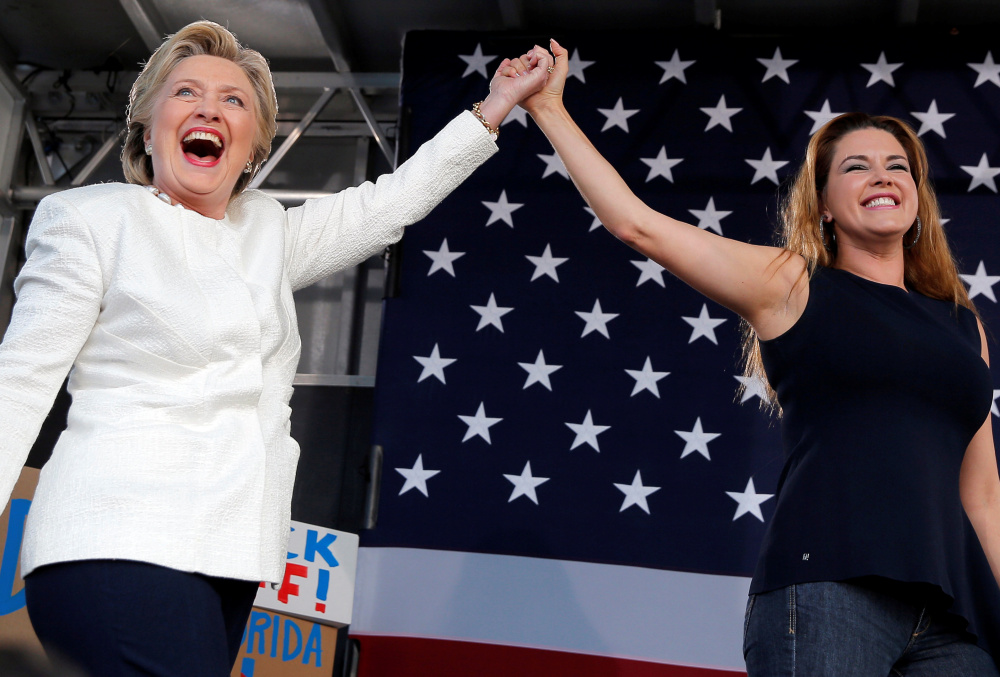 Hillary Clinton takes the stage with former Miss Universe Alicia Machado at a campaign rally at Pasco-Hernando State College in Florida on Tuesday.