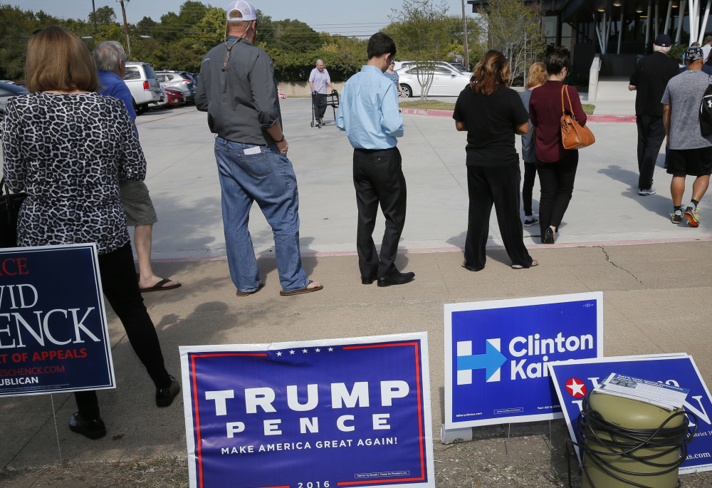 Early voters wait in line last week in Dallas. The level of early voting is in line with expectations but enthusiasm about candidates lags behind that of the 2012 election, a poll finds.