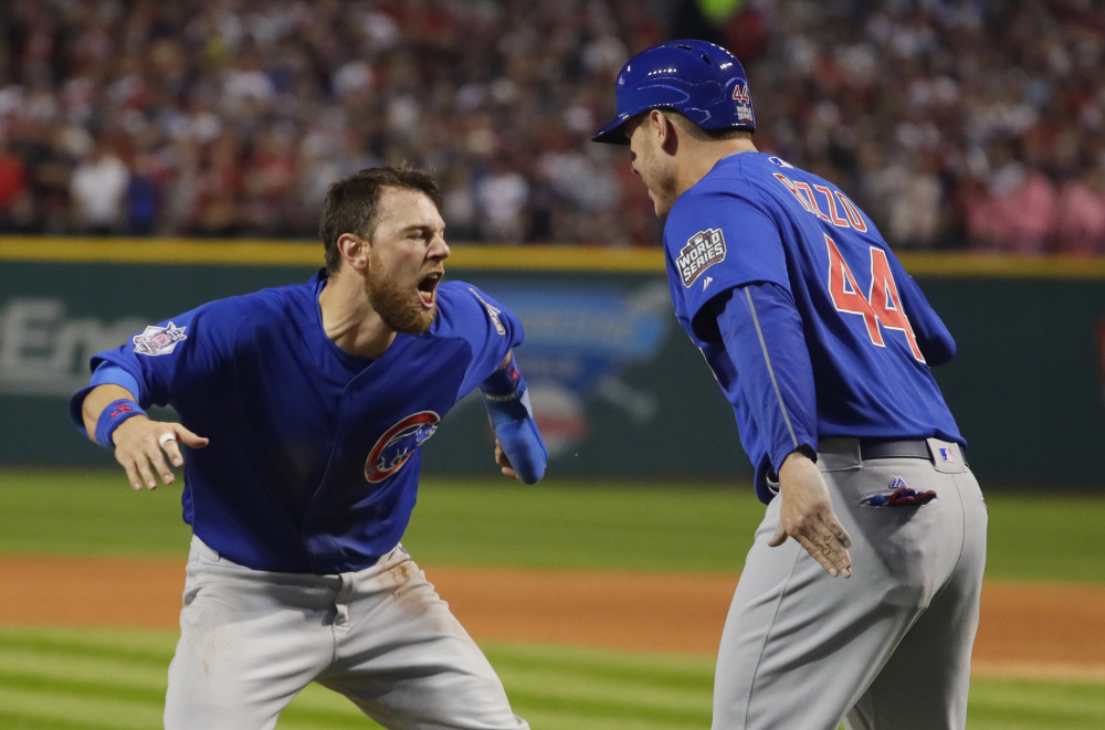 Chicago's Ben Zobrist celebrates with Anthony Rizzo after scoring in the first inning Tuesday night. The Cubs jumped out to a lead that they never gave up.