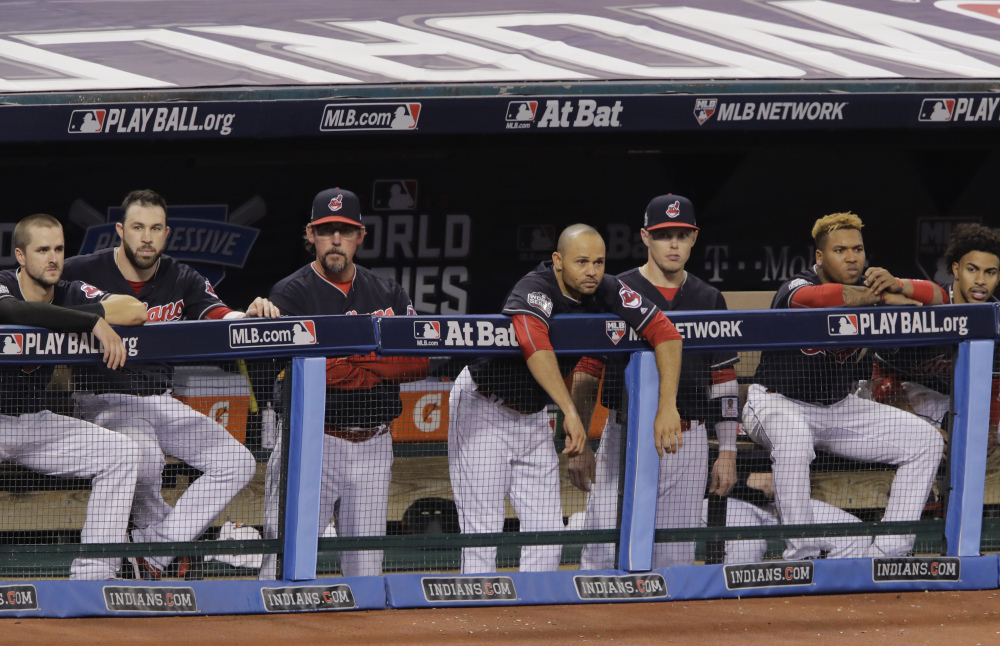 Cleveland players watch from the dugout in the decisive third inning of Game 6, watching their lead in the World Series slip away.