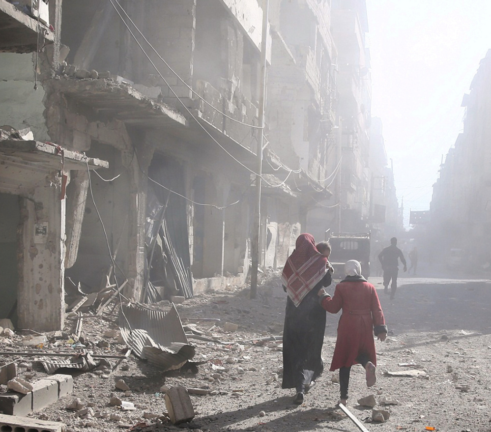 A bomb damaged site after an airstrike Wednesday in the rebel-held town of Douma in Damascus, Syria. Russia says its bombing there is no different than the U.S. Mosul offensive.