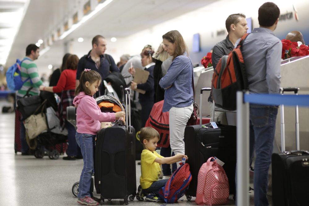Last year's Thanksgiving holiday travelers at Miami International Airport wait for security screening. This year the TSA has increased staffing and encouraged the use of PreCheck.