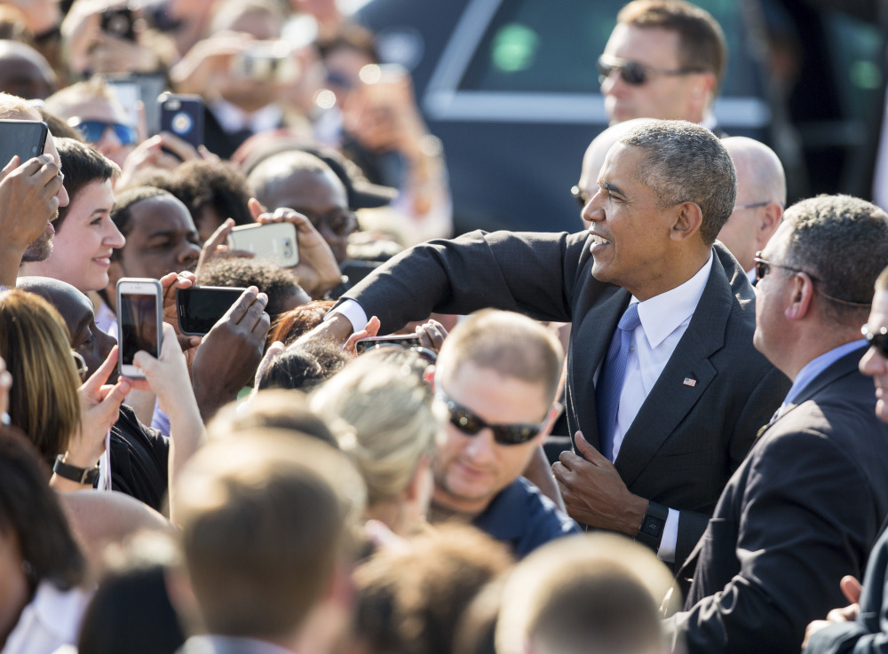 President Obama greets fans on the tarmac after arriving in Morrisville, N.C.,  on Wednesday.