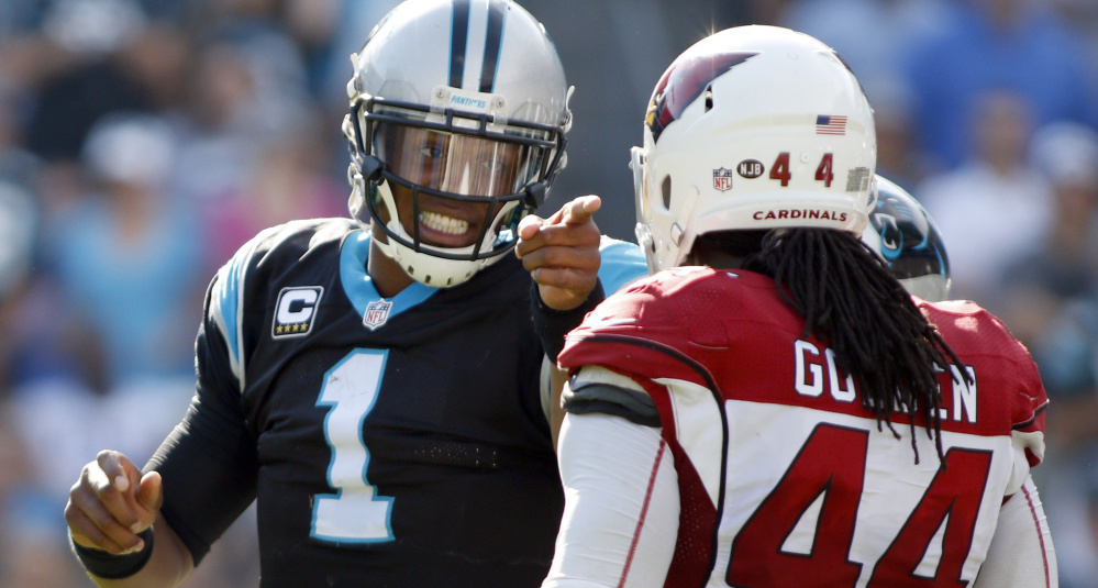 Carolina quarterback Cam Newton, who has complained about referees not making calls on hits against him, points at Arizona cornerback Markus Golden after Golden made what Newton felt was a late hit during a 30-20 Panthers' win on Sunday.