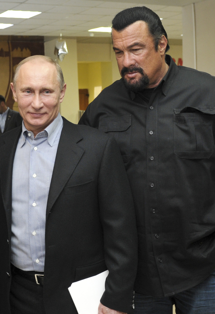Russian President Vladimir Putin, left, and U.S. movie actor Steven Seagal visit a new sports arena in Moscow in 2013. Alexei Nikolsky/Sputnik, Kremlin Pool Photo via AP