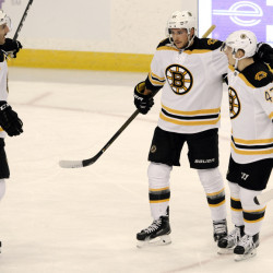 Boston's Patrice Bergeron, 37, and Torey Krug, 47, celebrate with Ryan Spooner after Spooner's goal against the Tampa Bay Lightning in the first period Thursday night in Tampa, Fla.
