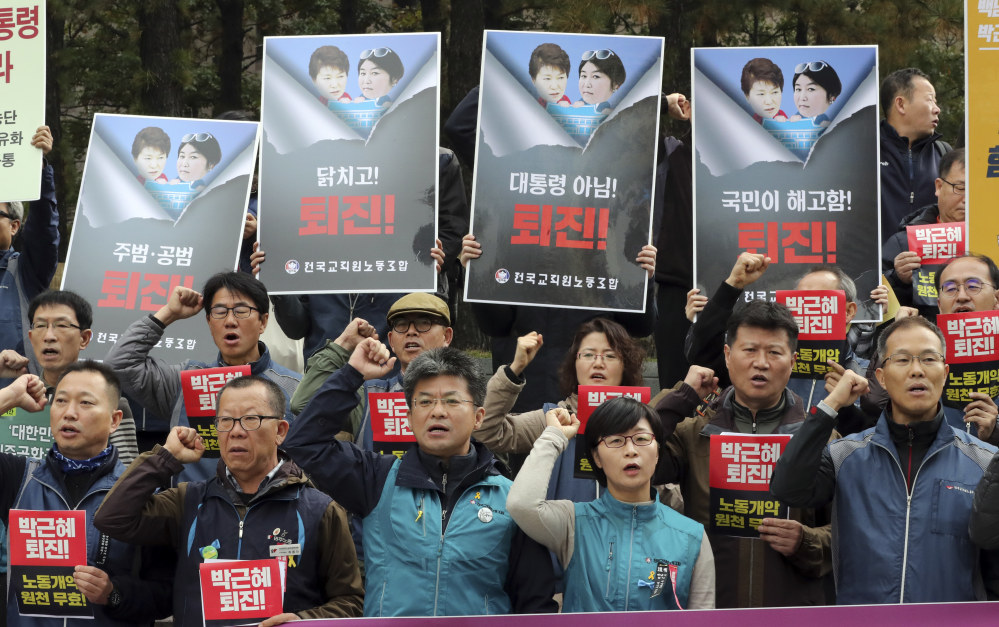 South Korean union members shout slogans during a rally calling for South Korean President Park Geun-hye to step down in downtown Seoul on Friday.