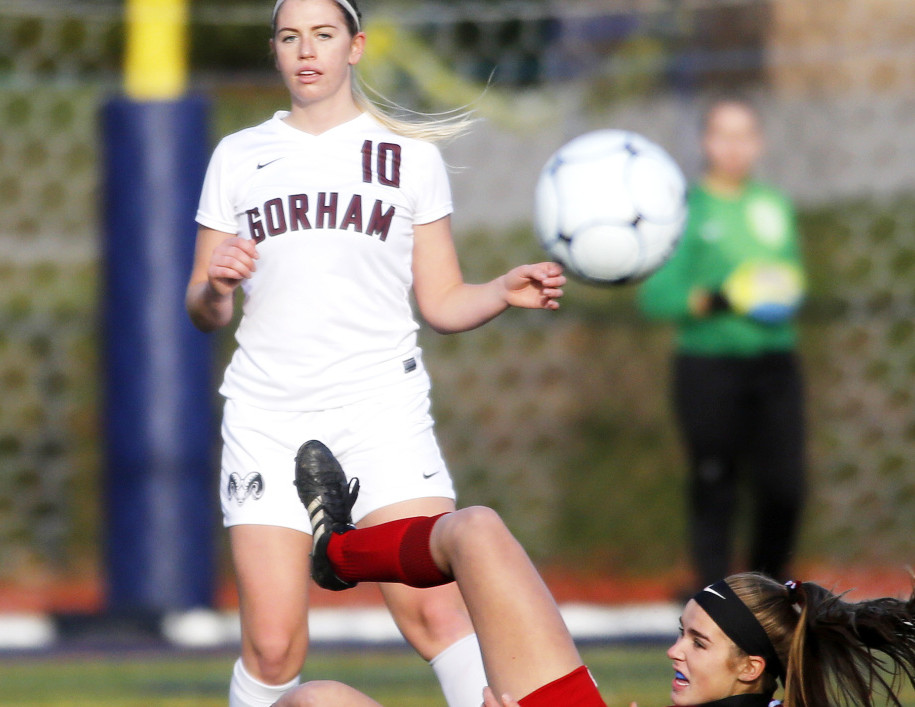 Gorham High's Meghan Perrin clears the ball after colliding with Eliza Roy of Camden Hills during the Class A girls' soccer championship at Fitzpatrick Stadium on Saturday. (Photo by Derek Davis/Staff Photographer)