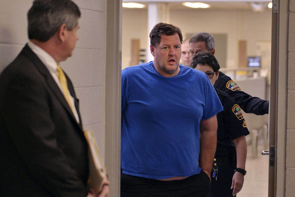 Todd Christopher Kohlhepp is escorted into a courtroom on Friday.