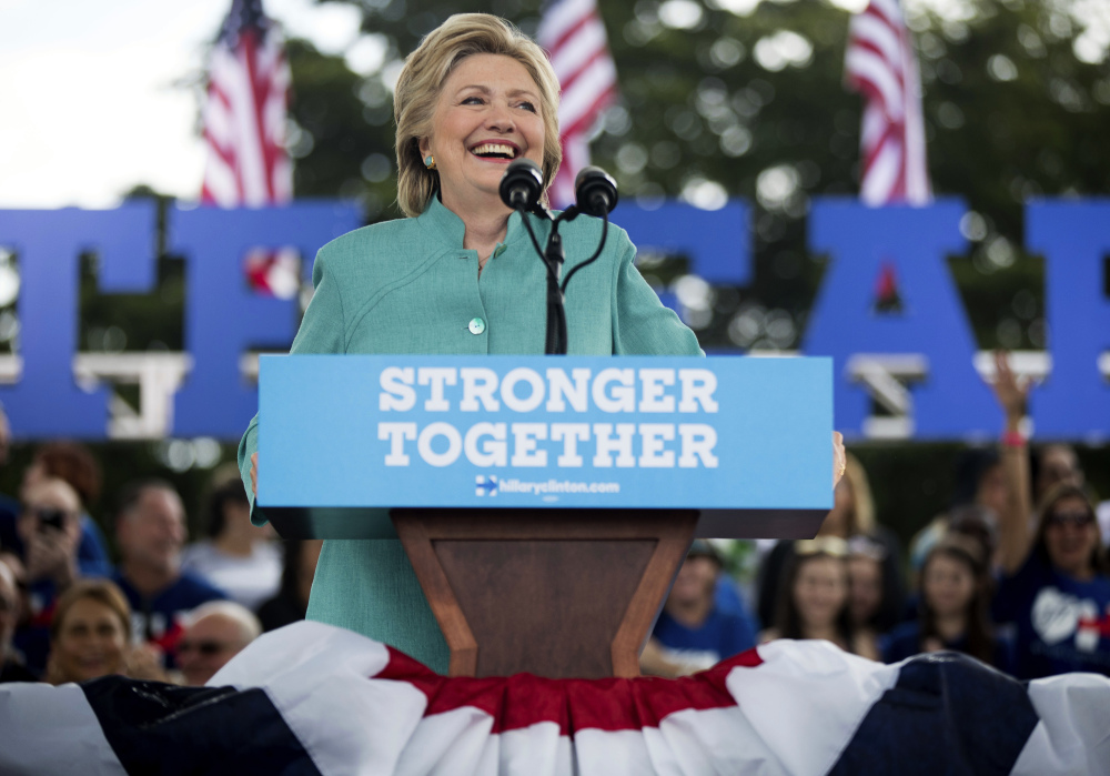 Hillary Clinton pauses while speaking at a rally at C.B. Smith Park in Pembroke Pines, Fla., on Saturday.