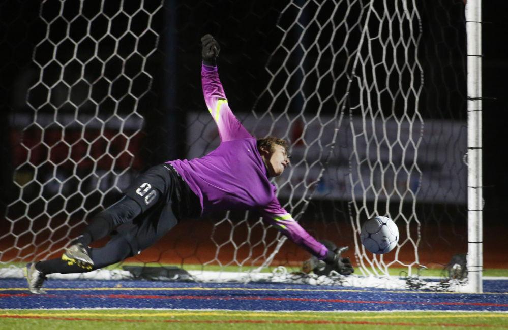 George Payne of Bangor stops a penalty kick by Andrew Rent of Gorham after the two teams played to a tie following two overtime periods. Bangor won on penalty kicks.