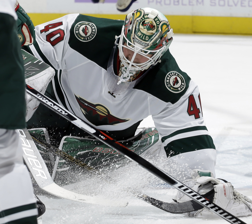 Minnesota Wild goalie Devan Dubnyk makes a save Saturday against Colorado. Dubnyk stopped 31 of the 32 shots he faced but was outdone by Calvin Pickard who made 32 saves in the Avalanche's 1-0 victory.