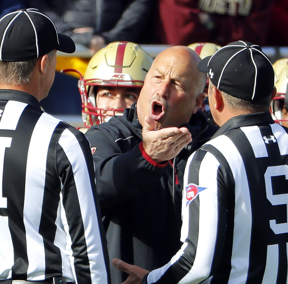 Boston College Coach Steve Addazio, center, argues with officials during Saturday's game in Chestnut Hill, Mass. Addazio had plenty to be upset about as his Eagles were crushed by No. 5 Louisville 52-7 to fall to 1-5 in Atlantic Coast Conference play.